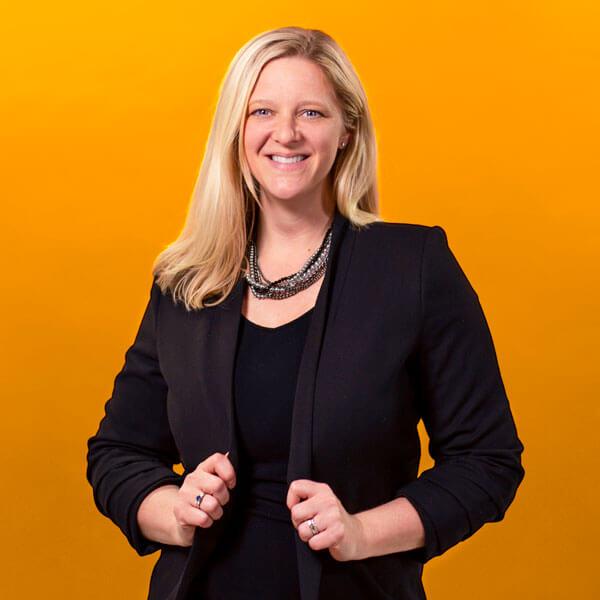Jill Mast headshot on orange background