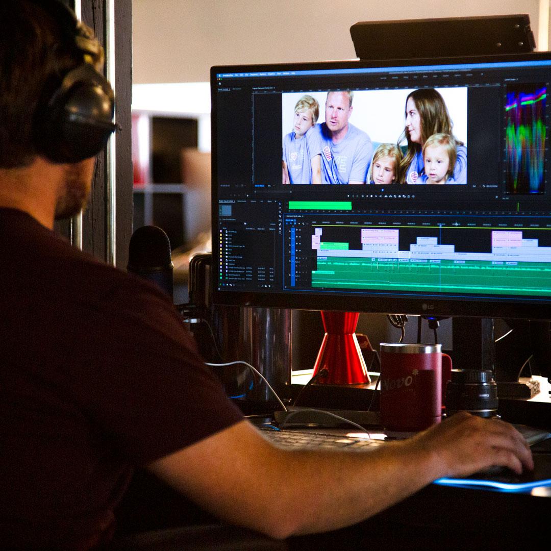 de Novo video producer Andrew editing a video