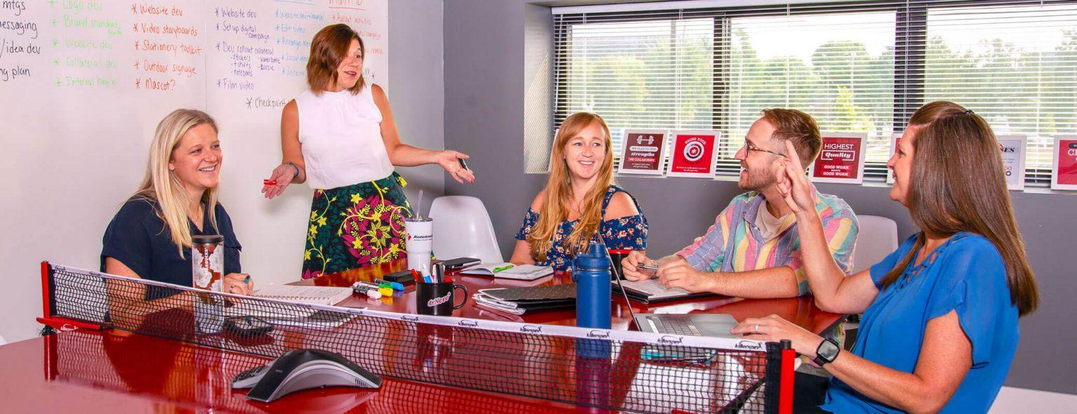 The de Novo account manager team having a meeting